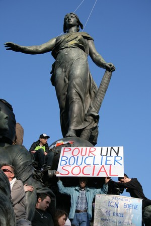 PARIS - MARCH 19: People demonstrate against tax policy during Frances second nationwide strike this year, to demand social security and protection form the crisis, on March 19, 2009, at Place de la Nation; Paris, France