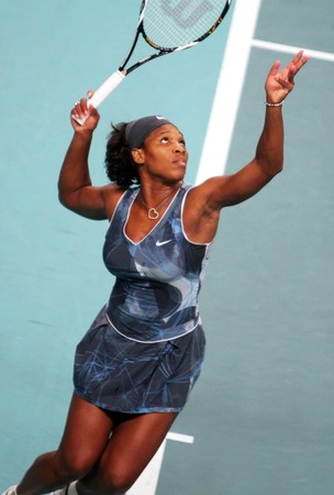 PARIS - FEBRUARY 13: US Serena Williams serves during her quater final match at Open GDF SUEZ WTA tournament, Pierre de Coubertin stadium on February 13, 2009 in Paris, France. Stock Photo - 7737329