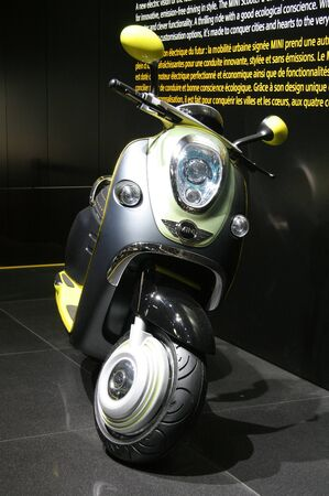 PARIS - OCTOBER 11: Mini Scooter E Concept is displayed at the Paris Motor Show 2010 at Porte de Versailles, on October 11, 2010 in Paris, France Stock Photo - 7996726