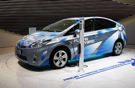 toyota: PARIS - OCTOBER 11: The Toyota Prius Plug-in Hybrid rechargeable automobile is displayed at the Paris Motor Show 2010 at Porte de Versailles, on October 11, 2010 in Paris, France
