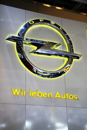 PARIS - OCTOBER 14: The Opel logotype and slogan We Love Cars is displayed at the companys stand during the Paris Motor Show 2010 at Porte de Versailles, on October 14, 2010 in Paris, France