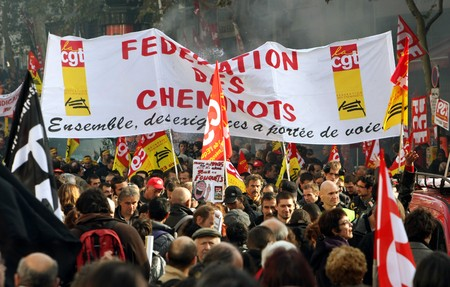syndicate: PARIS - OCTOBER 28: The train drivers march during the strike against the retirement age reform on October 28, 2010 in Paris, France