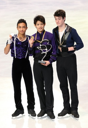 PARIS - NOVEMBER 27: Florent AMODIO (L), Takahiko KOZUKA, Brandon MROZ during the medal ceremony of the ISU Grand Prix Eric Bompard Trophy on NOVEMBER 27, 2010 at Palais-Omnisports de Bercy, Paris, France. Stock Photo - 8335444