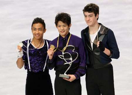 PARIS - NOVEMBER 27: Florent AMODIO (L), Takahiko KOZUKA, Brandon MROZ during the medal ceremony of the ISU Grand Prix Eric Bompard Trophy on NOVEMBER 27, 2010 at Palais-Omnisports de Bercy, Paris, France. Stock Photo - 8335487