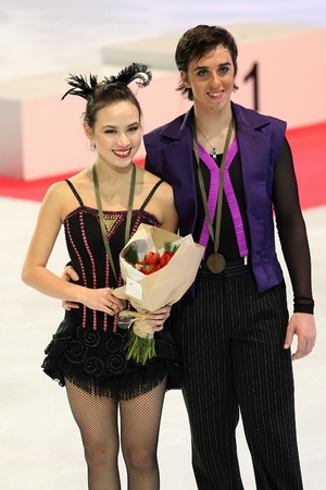 chock: PARIS - NOVEMBER 27: Madison CHOCK  Greg ZUERLEIN of USA pose at the medal ceremony after winning bronze at Eric Bompard Trophy on November 27, 2010 at Palais-Omnisports de Bercy, Paris, France.