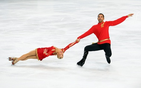 PARIS - NOVEMBER 26: Aliona SAVCHENKO and Robin SZOLKOWY of Germany perform during pairs short skating event at Eric Bompard Trophy on November 26, 2010 at Palais-Omnisports de Bercy, Paris, France.