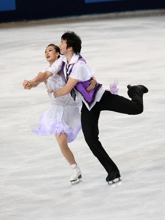 PARIS - NOVEMBER 26: Xintong HUANG / Xun ZHENG of China perform short dance at the ISU Grand Prix Eric Bompard Trophy on November 26, 2010 at Palais-Omnisports de Bercy, Paris, France. Stock Photo - 8335440