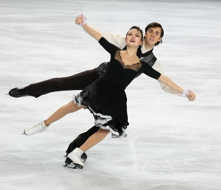 PARIS - NOVEMBER 26: Madison CHOCK and Greg ZUERLEIN of USA perform short dance at the ISU Grand Prix Eric Bompard Trophy on November 26, 2010 at Palais-Omnisports de Bercy, Paris, France. Stock Photo - 8335423