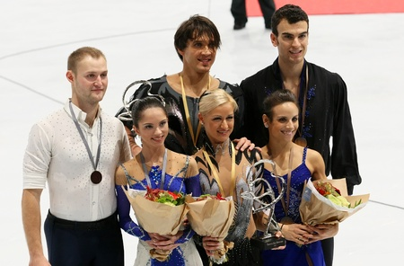PARIS - NOVEMBER 19: BAZAROVA/LARIONOV,VOLOSOZHAR/TRANKOV, DUHAMEL/RADFORD during the medal ceremony of the ISU Grand Prix Eric Bompard Trophy on NOVEMBER 19, 2011 at Palais-Omnisports de Bercy, Paris, France. Stock Photo - 11273741
