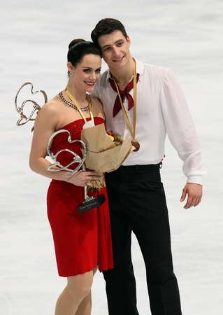 PARIS - NOVEMBER 19: Tessa VIRTUE and Scott MOIR (CAN) pose during the medal ceremony after winning gold at Eric Bompard Trophy November 19, 2011 at Palais-Omnisports de Bercy, Paris, France.