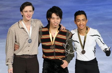 PARIS - NOVEMBER 17: Jeremy ABBOTT (L), Takahito MURA, Florent AMODIO during the medal ceremony of the ISU Grand Prix Eric Bompard Trophy on NOVEMBER 17, 2012 at Palais-Omnisports de Bercy, Paris, France.