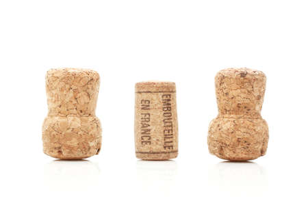 Wine and champagne corks isolated on white photo