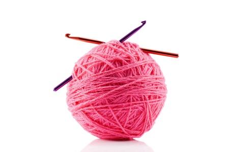 crotchet: Pink yarn and crotchet hooks isolated on white
