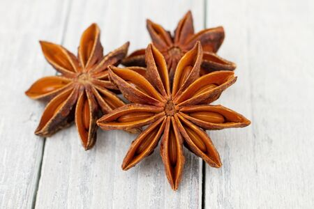 Star Anise spice on wooden background