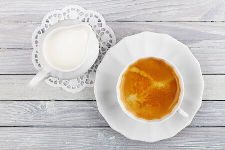 coffee and cream jug on a wooden table