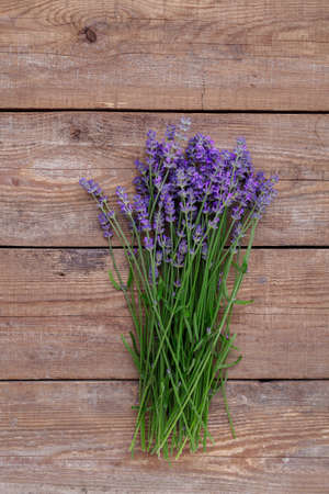 Lavender flowers on a wooden background 写真素材