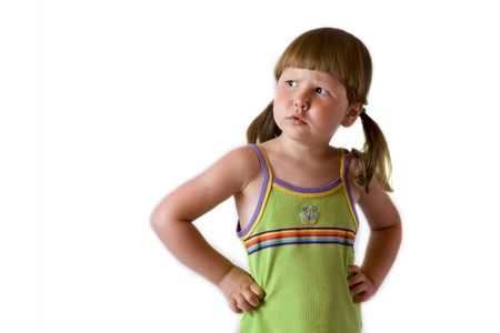 ponytails: Worried little girl with ponytails in green top Stock Photo