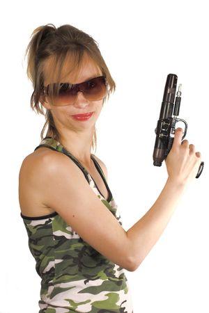 Dangerous blondie wearing sunglasses holding gun photo