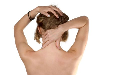 Exhausted girl making self-massage of her neck isolated photo