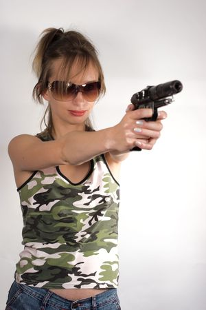 Girl wearing sunglasses and uniform is aiming with smile Stock Photo - 1282049