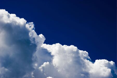 Majestic Cloudscape in vivid dark blue skyes background Stock Photo