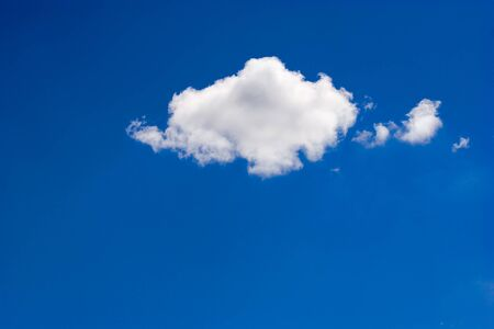Single simple cloud over deep blue vivid skyes