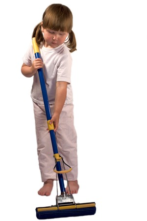 broom handle: Upset tired little girl cleaning house with mop isolated on white Stock Photo