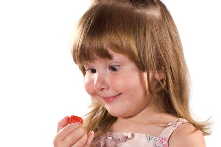 Funny little girl with sreawberry in her hand isolated on white Stock Photo - 1637946