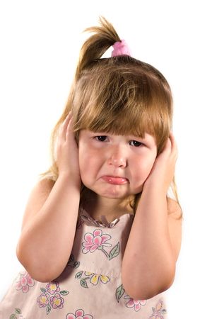 tantrum: Upset almost crying little girl afraid of smth isolated on white Stock Photo