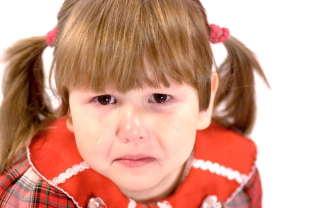 snivel: Portrait of crying little girl tears on her cheeks isolated on white Stock Photo
