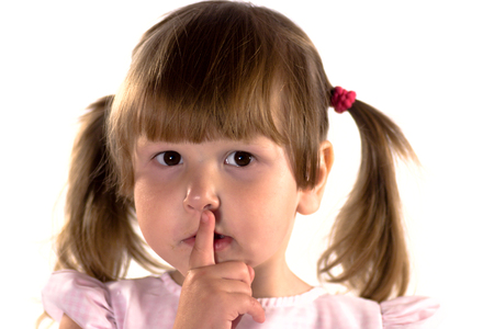 ponytails: Little girl making sign of silence isolated on white