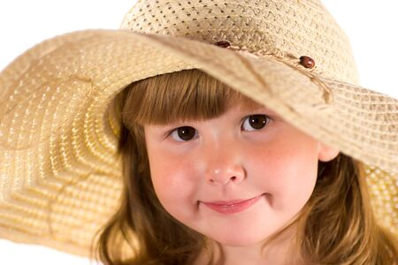 Portrait of gorgeous little girl with brown eyes wearing straw hat isolated on white Stock Photo