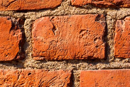Ancient abandoned red brick wall textured backround photo