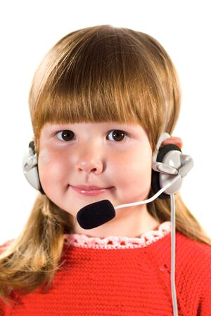 Little girl with headset wearing red dress looking at you and smiling isolated on white photo