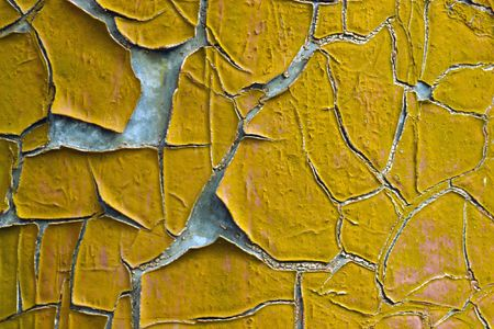 peeling paint: Old wall with dirty broken weathered yellow paint Stock Photo
