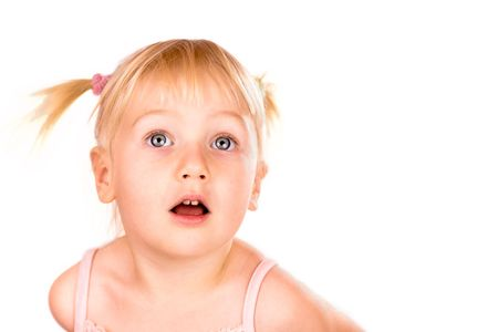 Little girl looking up with open mouth isolated on white Stock Photo
