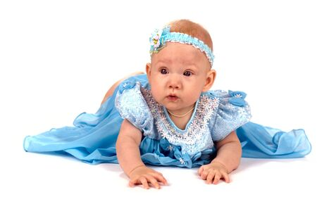 festal: Baby girl wearing holiday blue dress lying on the floor