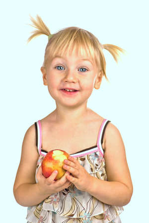Girl holding red biten by her apple isolated on white Stock Photo - 2114336