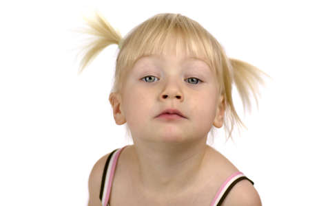 ponytails: Studio portrait of pensive two years old little girl with ponytails looking up at you Stock Photo