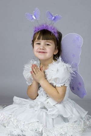 Studio portrait of little girl dressed for holiday as fairy photo