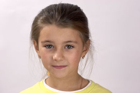 nine years old: Studio headshot of nine years old girl looking in your eyes Stock Photo