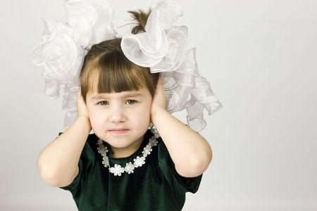 Worried girl with huge bows dressed for holiday Stock Photo - 2481483