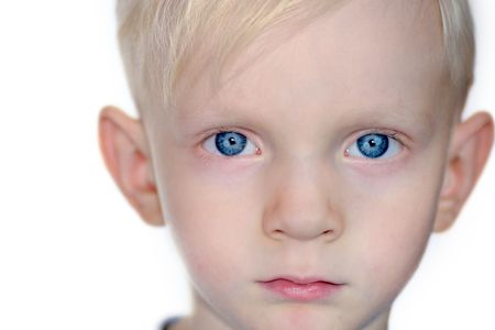 Portrait of a serious boys part of face with blue eyes isolated