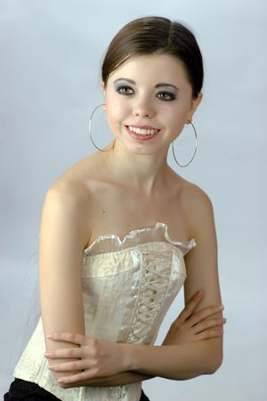 Beautiful young woman wearing corset and huge silver earrings smiling photo