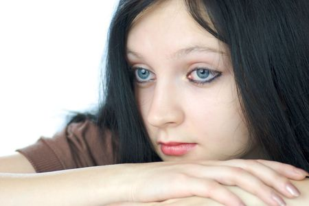 Portrait of pensive young woman with blue eyes lookiing away isolated on white photo
