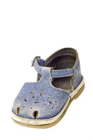 Used blue child sandal isolated on white