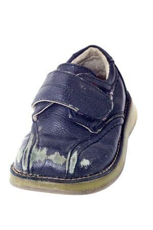 Used black child shoe isolated on white Stock Photo