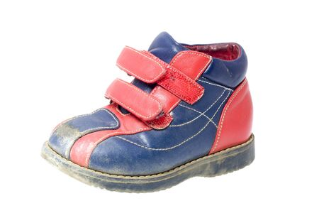 heirlooms: Used red-blue child shoe isolated on wite Stock Photo