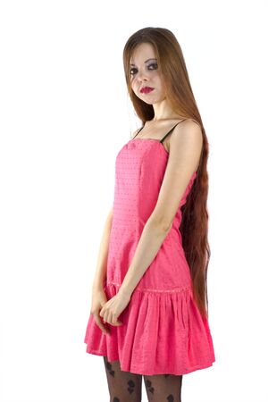 Portrait of a Beautiful brunette woman wearing pink dress isolated on white photo