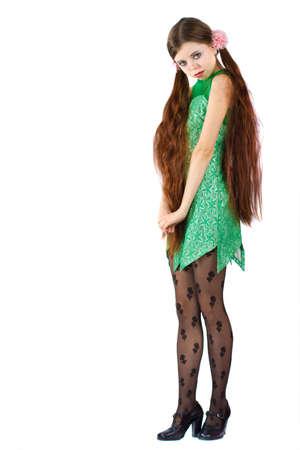 Portrait of a Beautiful brunette woman wearing green dress isolated on white photo